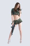 Sexy girl with gun Royalty Free Stock Images