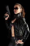 Girl with gun. Isolated on Black royalty free stock photography