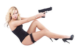 Girl with gun. Isolated on white stock photography