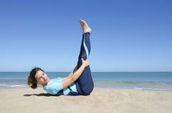 girl gymnastics at a tropical beach Stock Image