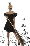 Sexy girl in halloween suit with broom Stock Photo