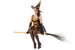 girl in Halloween witch flies on broom Royalty Free Stock Photo