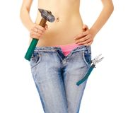 girl with hammer ang pliers royalty free stock photography