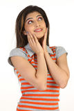 girl with hands on her cheeks Stock Photo