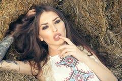 Sexy girl in hay barn. Desire, erotic stock photo