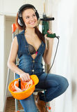 Sexy  girl in headphones with tools Stock Photography