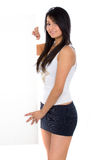 Sexy girl holding an add Stock Images