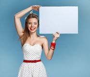 Sexy girl holding a billboard add Royalty Free Stock Photography