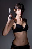 Sexy girl holding a black gun Stock Images