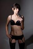 Sexy girl holding a black gun. Stock Image