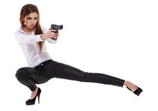 Sexy girl holding  black gun Royalty Free Stock Photography