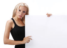 Sexy girl holding a blank board Stock Photography