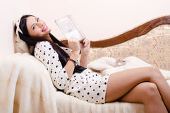 Sexy girl holding book and happy smiling Stock Image