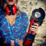 Sexy Girl holding a Bulgarian tool Royalty Free Stock Photos