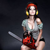 Sexy Girl holding a chainsaw Stock Image