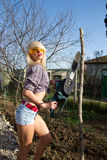 Sexy Girl holding a chainsaw Royalty Free Stock Photos