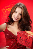 girl holding a christmas gift in packing stock photography