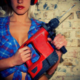 Sexy Girl holding a drill Stock Photography