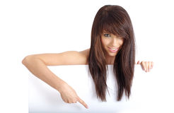 Sexy girl holding empty white board Royalty Free Stock Photos