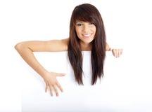 Sexy girl holding empty white board Stock Photos