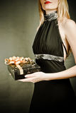Sexy girl holding a gift Royalty Free Stock Image