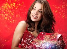Sexy girl  holding a gift in magic packing Royalty Free Stock Photography