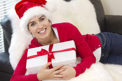 Sexy girl holding a gift in packing Royalty Free Stock Photos