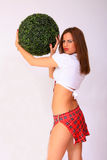 girl holding the green ball Stock Photo