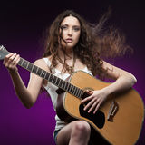 Sexy girl holding guitar Royalty Free Stock Images