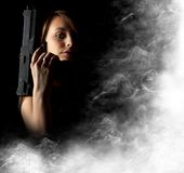 Sexy girl holding gun Stock Photography