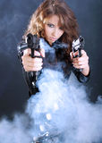 Sexy girl holding gun Stock Images