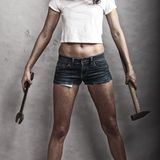 Sexy girl holding hammer and wrench spanner Royalty Free Stock Images