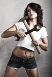 Sexy girl holding hammer and wrench spanner Stock Image