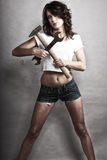 girl holding hammer and wrench spanner Royalty Free Stock Images