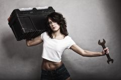 Sexy girl holding toolbox and wrench spanner. Sex equality and feminism. Sexy girl holding toolbox and wrench spanner tool. Attractive woman working as repairman Royalty Free Stock Images