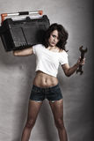 Sexy girl holding toolbox and wrench spanner Royalty Free Stock Photography