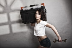 Sexy girl holding toolbox and wrench spanner. Sex equality and feminism. Sexy girl holding toolbox and wrench spanner tool. Attractive woman working as repairman Royalty Free Stock Photo