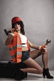 Sexy girl holding wrench spanner and hammer Royalty Free Stock Photo