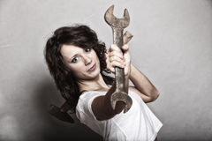 Sexy girl holding wrench spanner tool Stock Photography