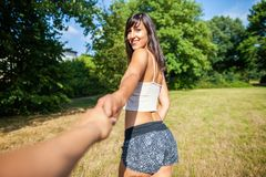 girl holds a mans hand royalty free stock photography