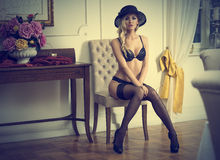 Sexy girl indoor with hat Royalty Free Stock Photo
