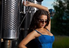 Sexy girl in jeans stand near steel truck Royalty Free Stock Image
