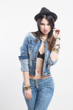 Sexy girl in jeans vest and hat Royalty Free Stock Photography