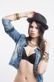 Sexy girl in jeans vest and hat Stock Photo