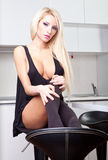 Sexy girl in kitchen Stock Image