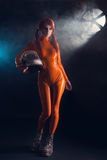 Sexy girl in latex catsuit, sci-fi theme Royalty Free Stock Image