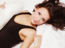 Sexy girl lazy woman lying on bed in bedroom Royalty Free Stock Photo