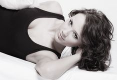 Sexy girl lazy woman with pillow on bed in bedroom Royalty Free Stock Photography
