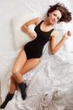 Sexy girl lazy woman with pillow on bed in bedroom Stock Photo