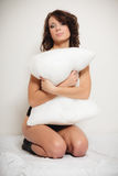 Sexy girl lazy woman with pillow on bed in bedroom Stock Photography